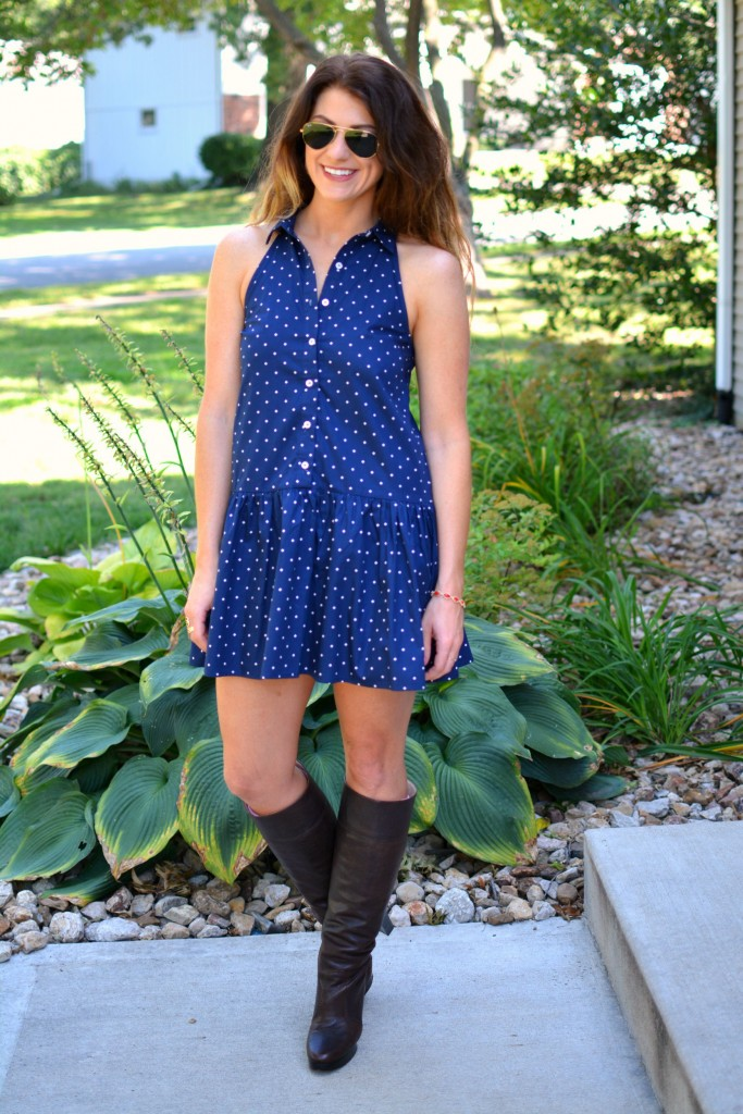 ashley from lsr in a navy polka dot dress, kendra scott elle earrings and jana bracelet, and michael kors boots
