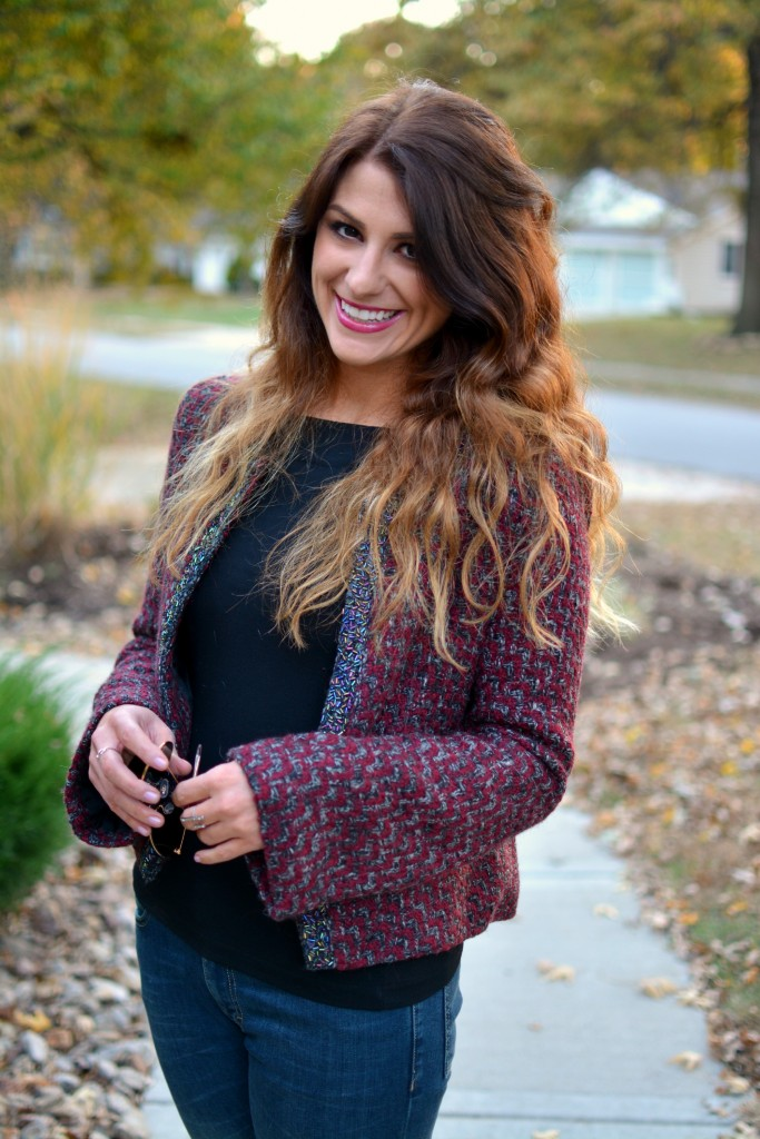 Ashley from LSR in a tweed jacket and black top.