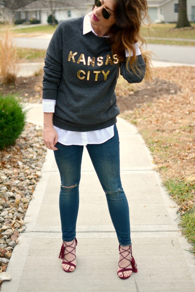 Ashley from LSR in a LocalE sweatshirt, Sincerely Jules jeans, and burgundy suede tassel sandals