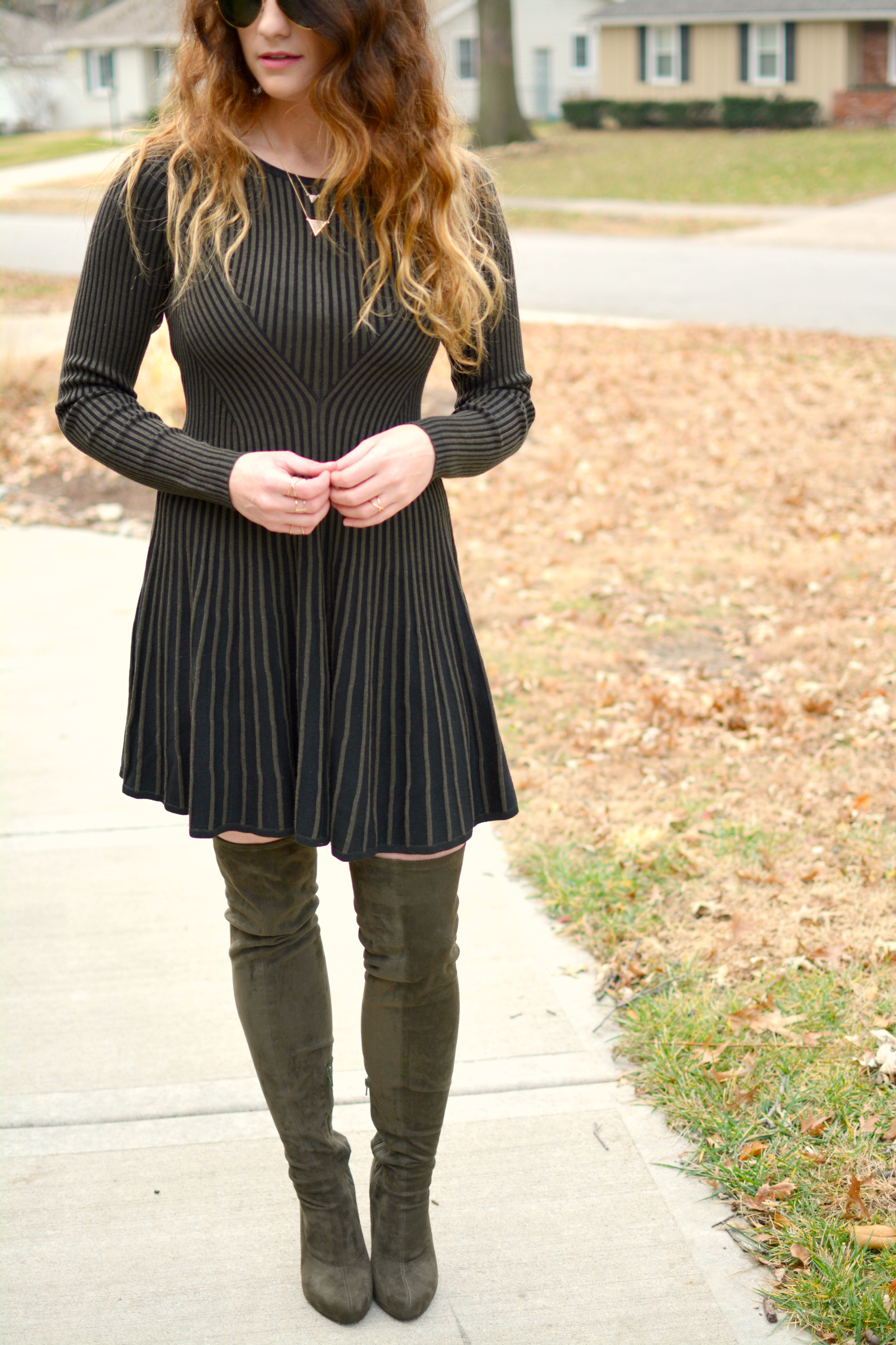 Ashley from LSR in an Express sweater dress and over-the-knee olive green boots.