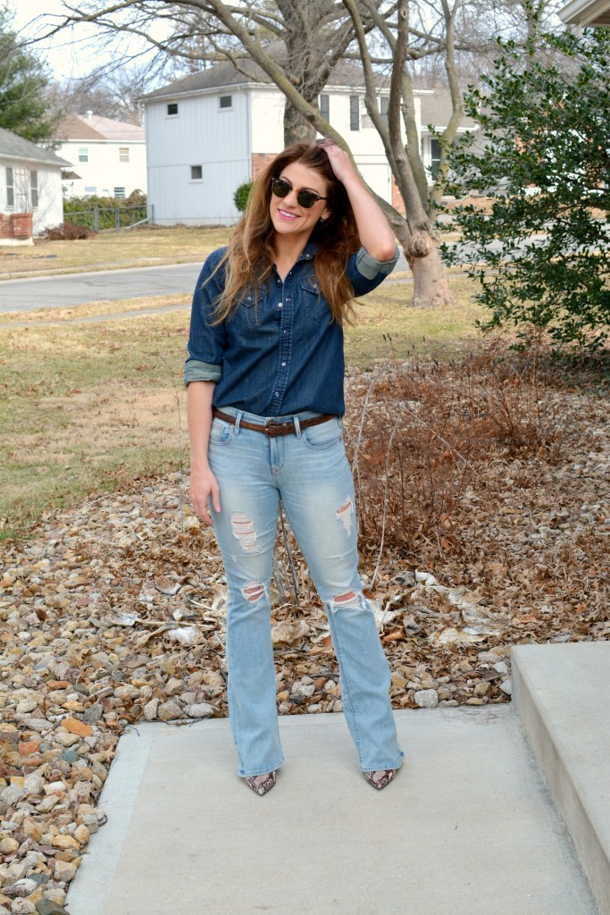 Ashley from LSR in Ray-Ban Clubmaster sunglasses, flare jeans, and a denim shirt