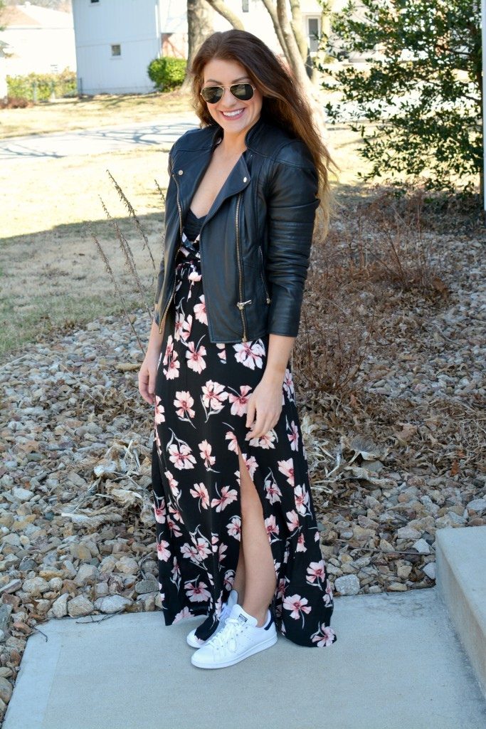 Ashley from LSR in a floral maxi dress, leather jacket, and Stan Smith sneakers