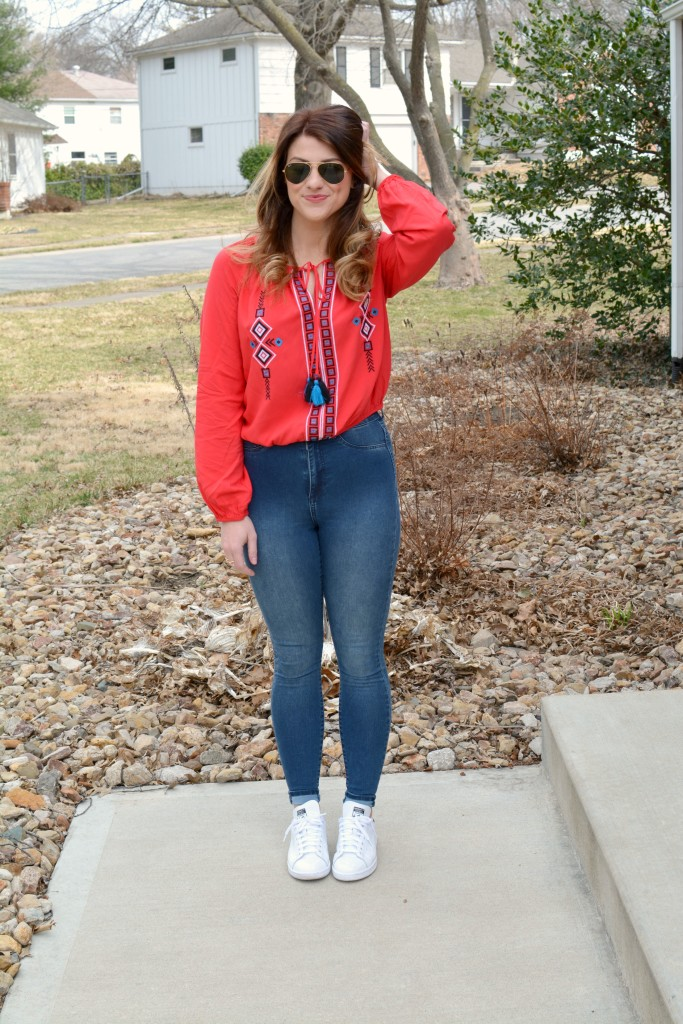 Ashley from LSR in a red peasant blouse and Stan Smith sneakers