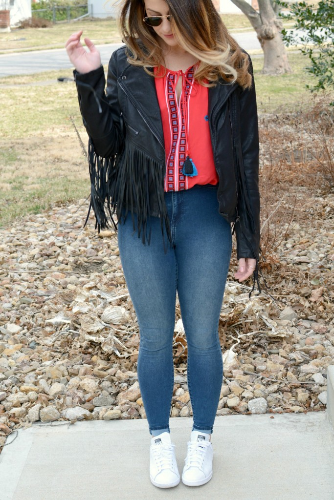 Ashley from LSR in a fringe faux leather jacket, peasant blouse, and Stan Smith sneakers