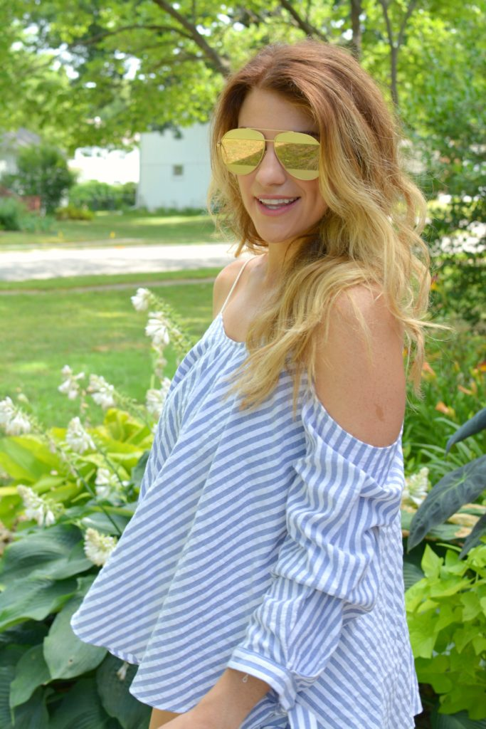 Ashley from LSR in an off-the-shoulder striped top and rose gold aviator sunglasses