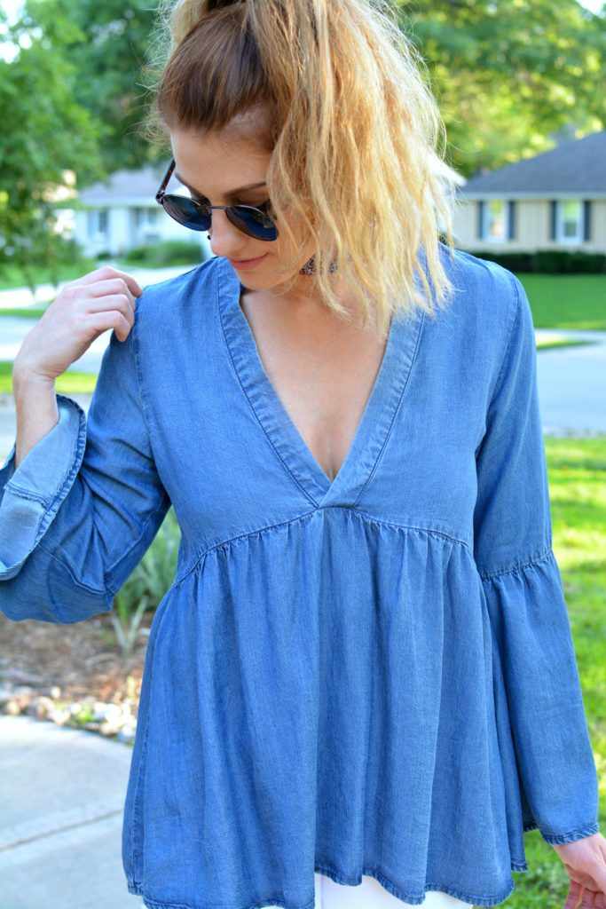 Ashley from LSR in a denim peasant top and round sunglasses