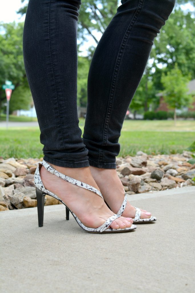 Ashley from LSR in black jeans and white marble sandals