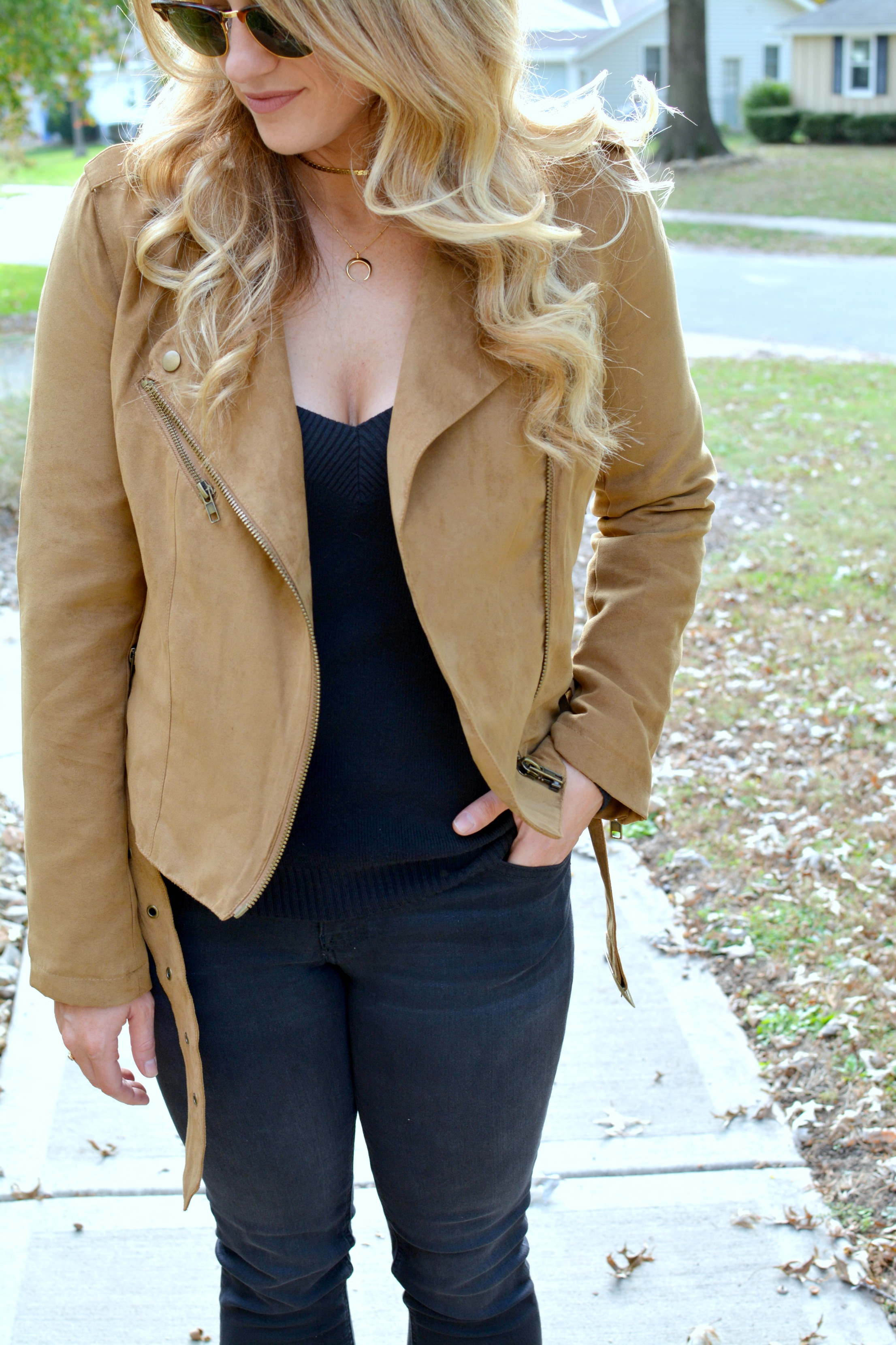 Ashley from LSR in a tan suede jacket, black jeans, and a black sweater
