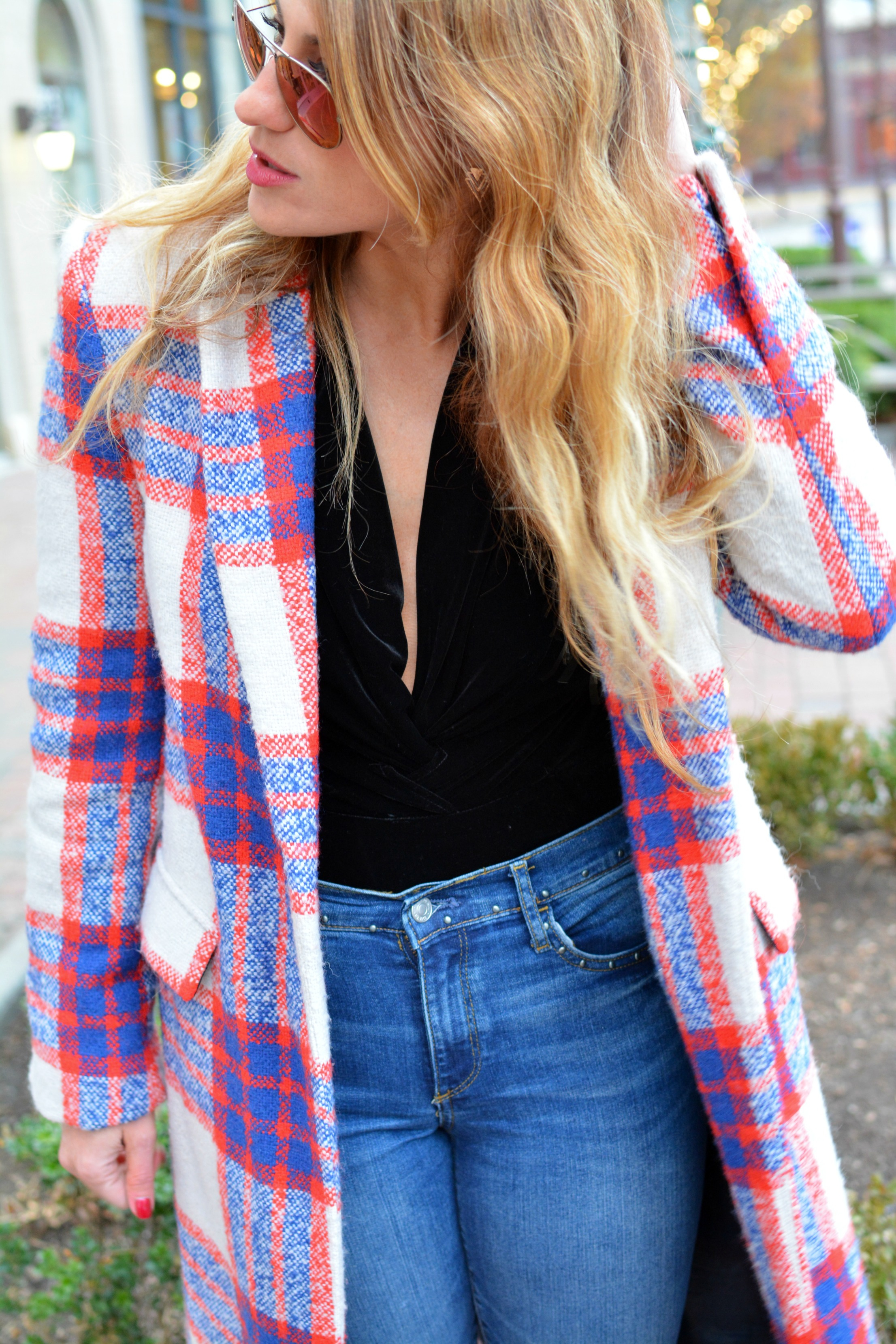 Ashley from LSR in a plaid statement coat and velvet bodysuit