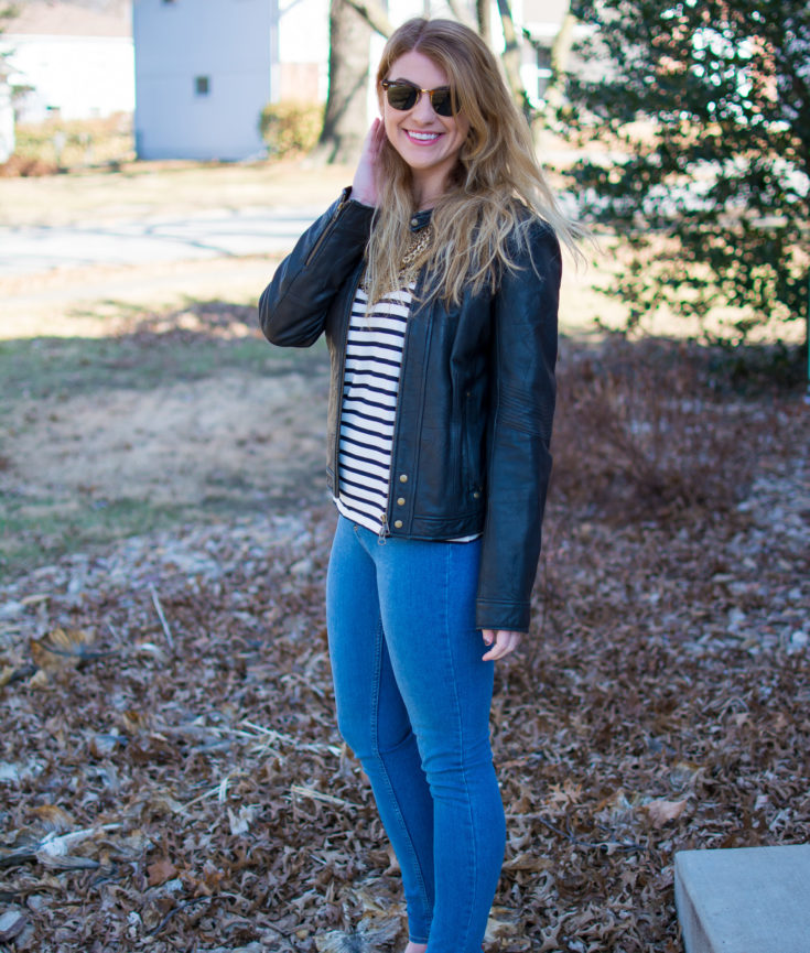 Ashley from LSR in a stripe tee, leather jacket, and gold cap toe suede pumps
