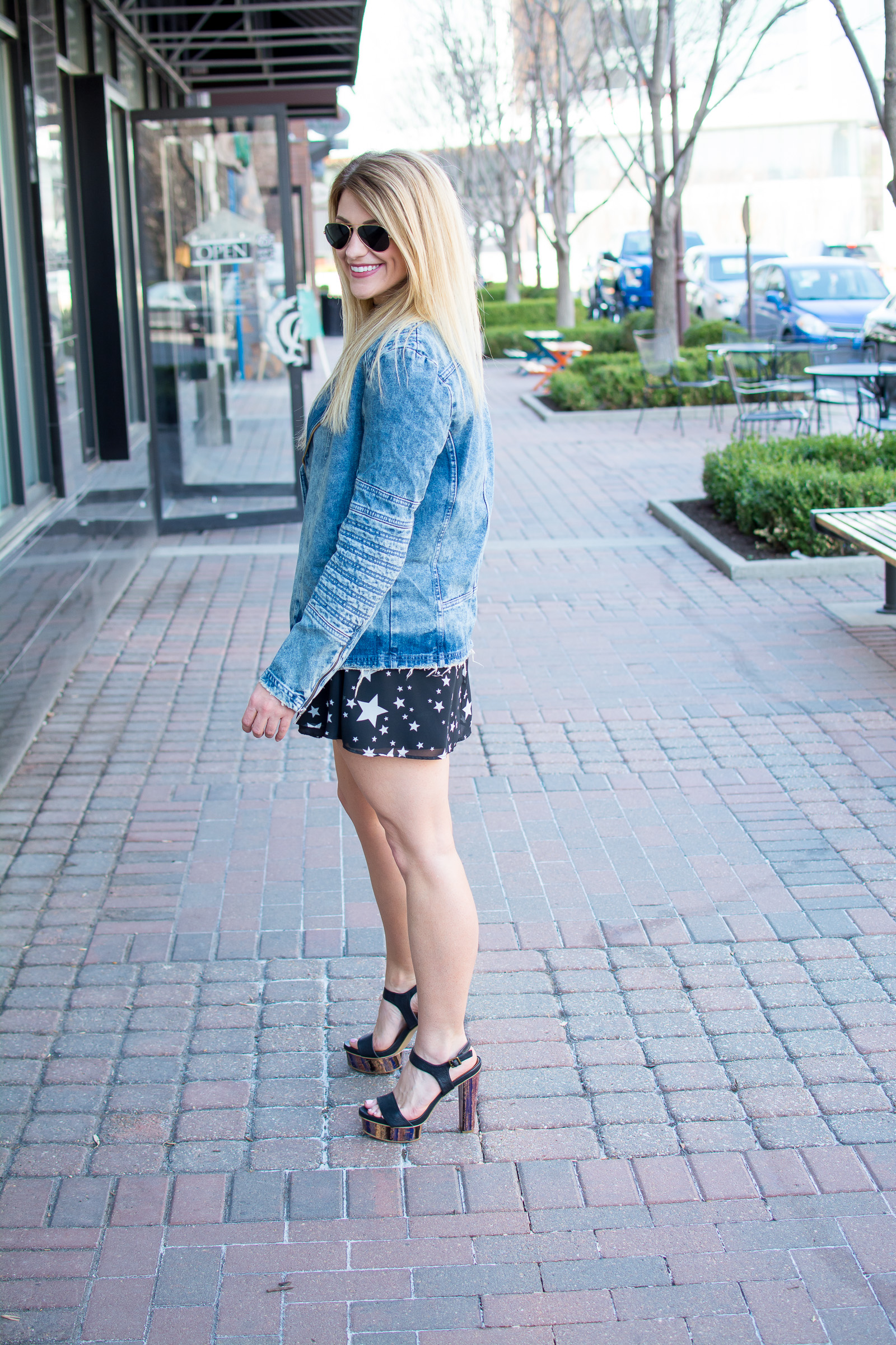 Spring Outfit Idea: Star Print Dress with a Men's Denim Jacket.   Ashley from Le Stylo Rouge
