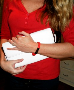 red henley, white clutch, red cuff,