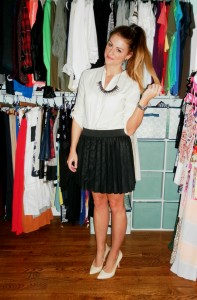 cream blouse, pleated leather skirt