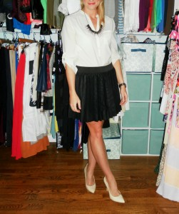 cream blouse, pleated leather skirt