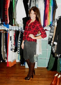 lumberjack plaid shirt, faded black jeans, tall boots