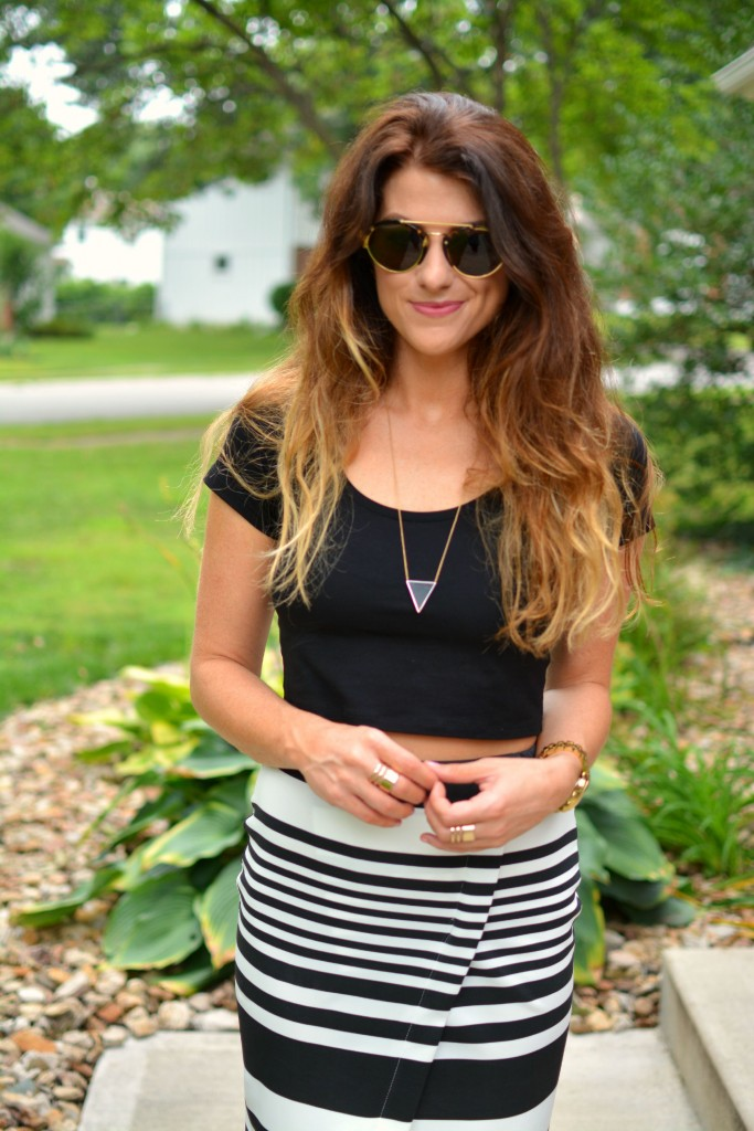 ashley from lsr in an asos crop top and striped midi skirt, illesteva sunglasses