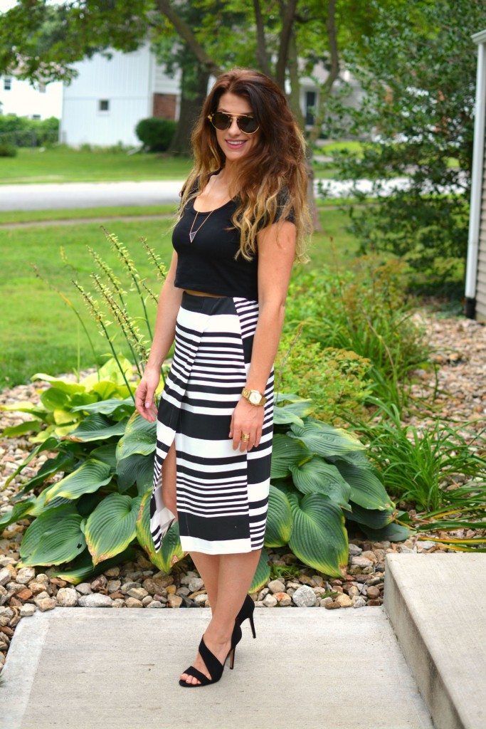 ashley from lsr in an asos crop top and striped midi skirt