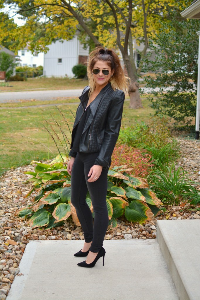 Ashley from LSR in a black leather jacket and black jeans with black suede pumps