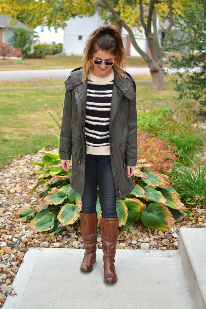 Ashley from LSR in a lightweight parka (glastonbury coat), black denim, and riding boots.