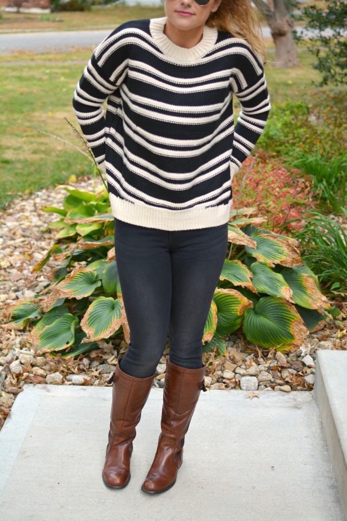 Ashley from LSR in a striped H&M sweater and black jeans, with riding boots.