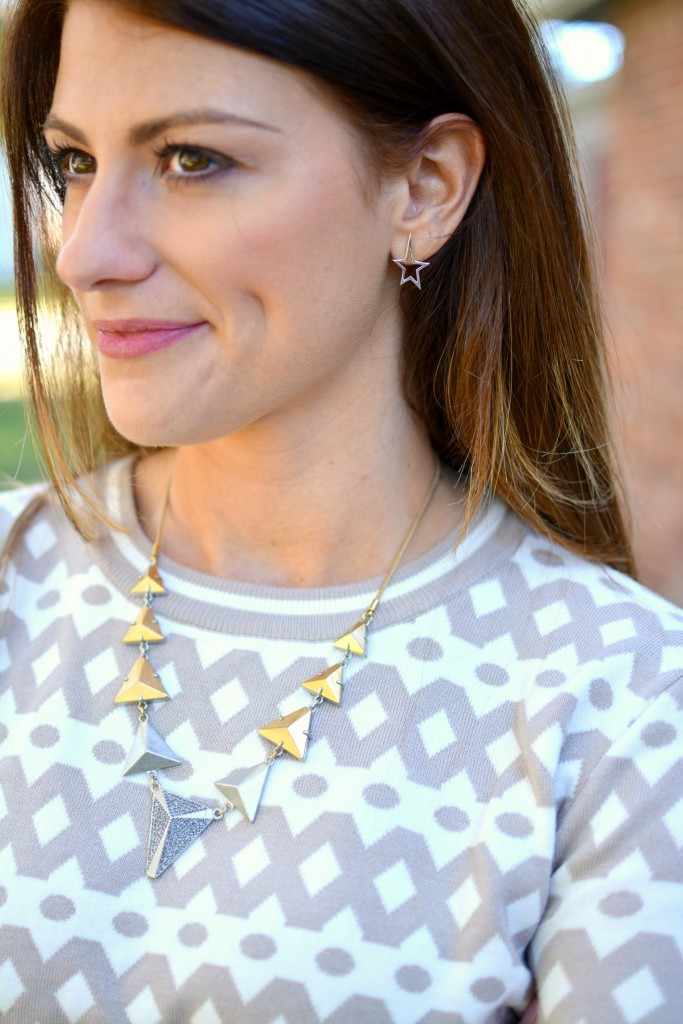 Ashley from LSR in a cropped printed sweater, madewell necklace, and janesko earrings