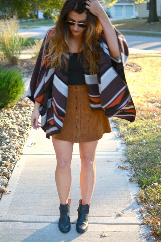 Ashley from LSR in an Old Navy poncho, tan suede skirt, and Jeffrey Campbell booties.