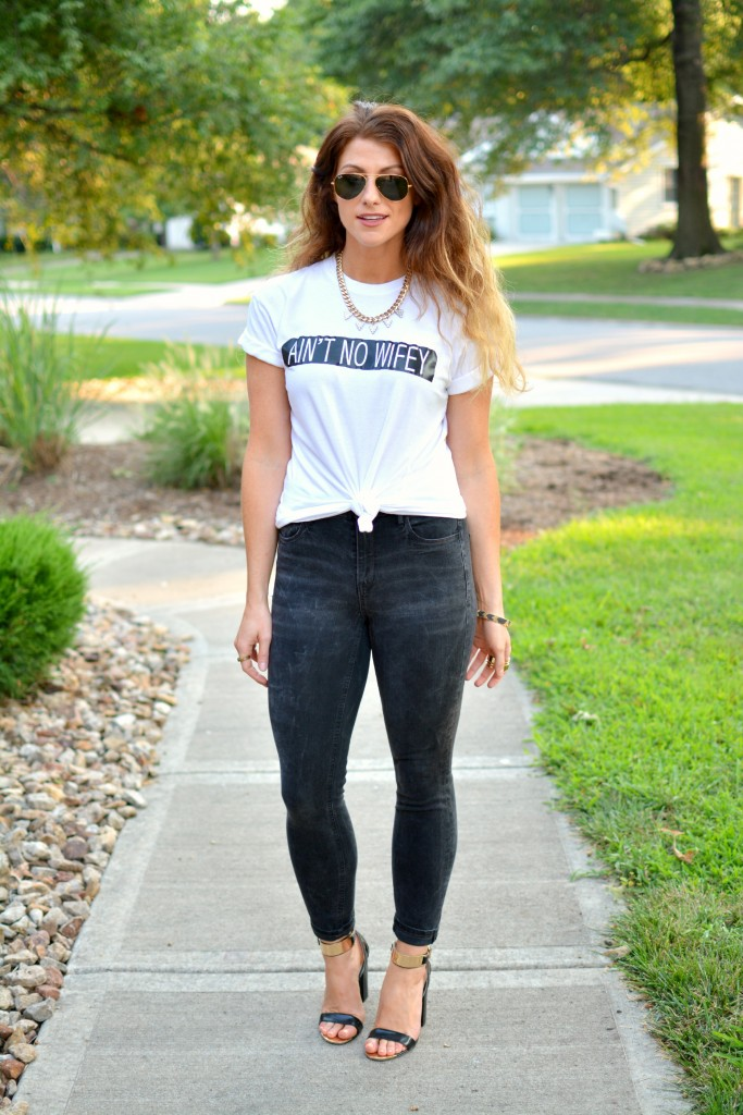 Ashley from LSR in an Ain't No Wifey tee, Madewell jeans, and Topshop sandals.