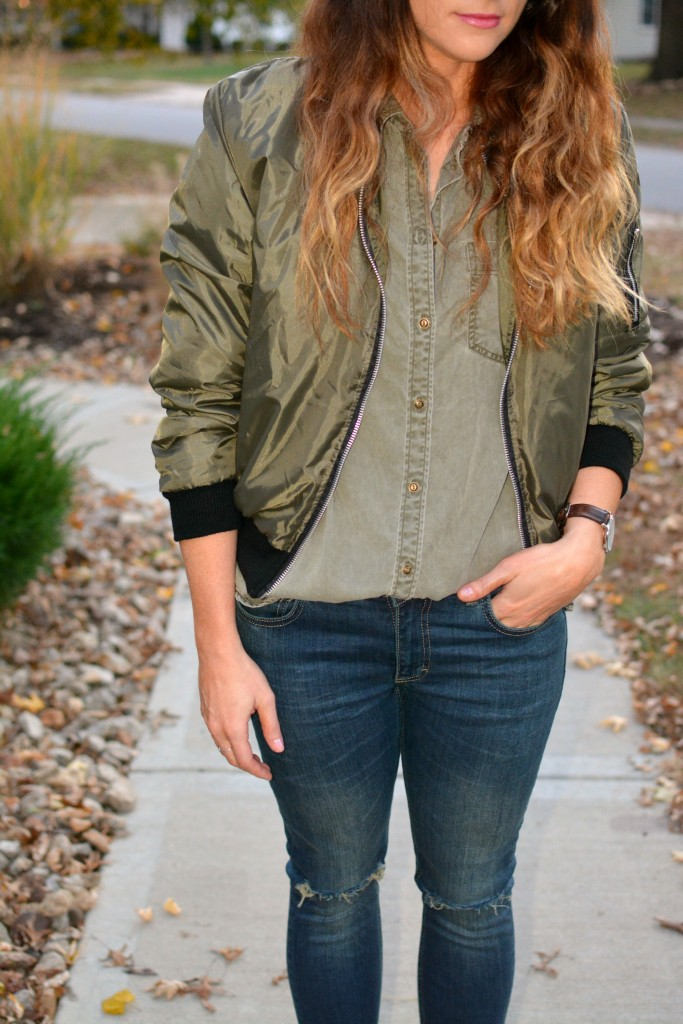 Ashley from LSR in an olive green bomber jacket and Express shirt, and Sincerely Jules jeans.