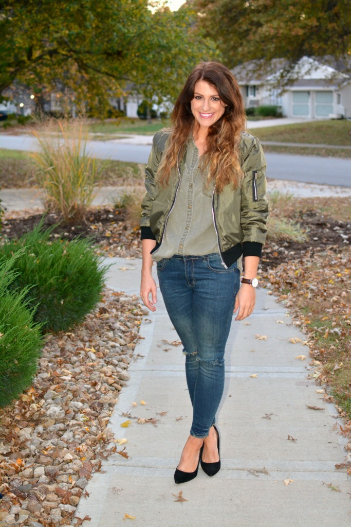 Ashley from LSR in an olive green bomber jacket, Sincerely Jules jeans, and black pumps.