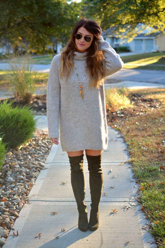 Ashley from LSR in a slouchy beige sweater and olive green over the knee boots.