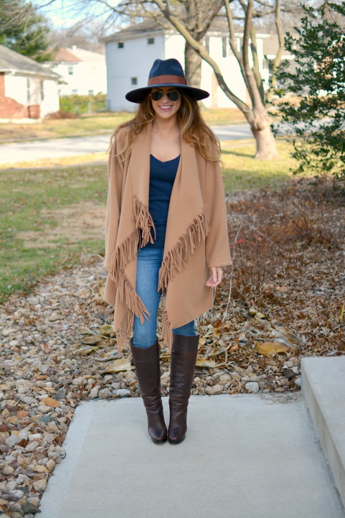 Ashley from LSR in a JOA fringe coat and Michael Kors boots.