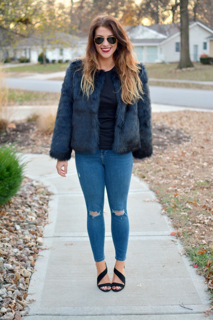 Ashley from LSR in a navy faux fur coat and heels from H&M.