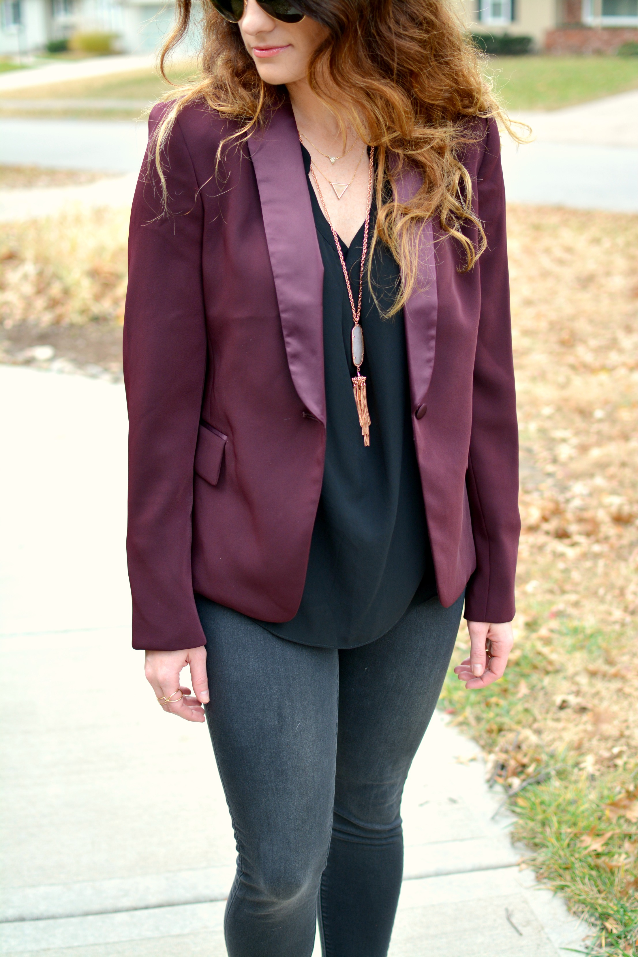 Ashley from LSR in a burgundy blazer and black denim