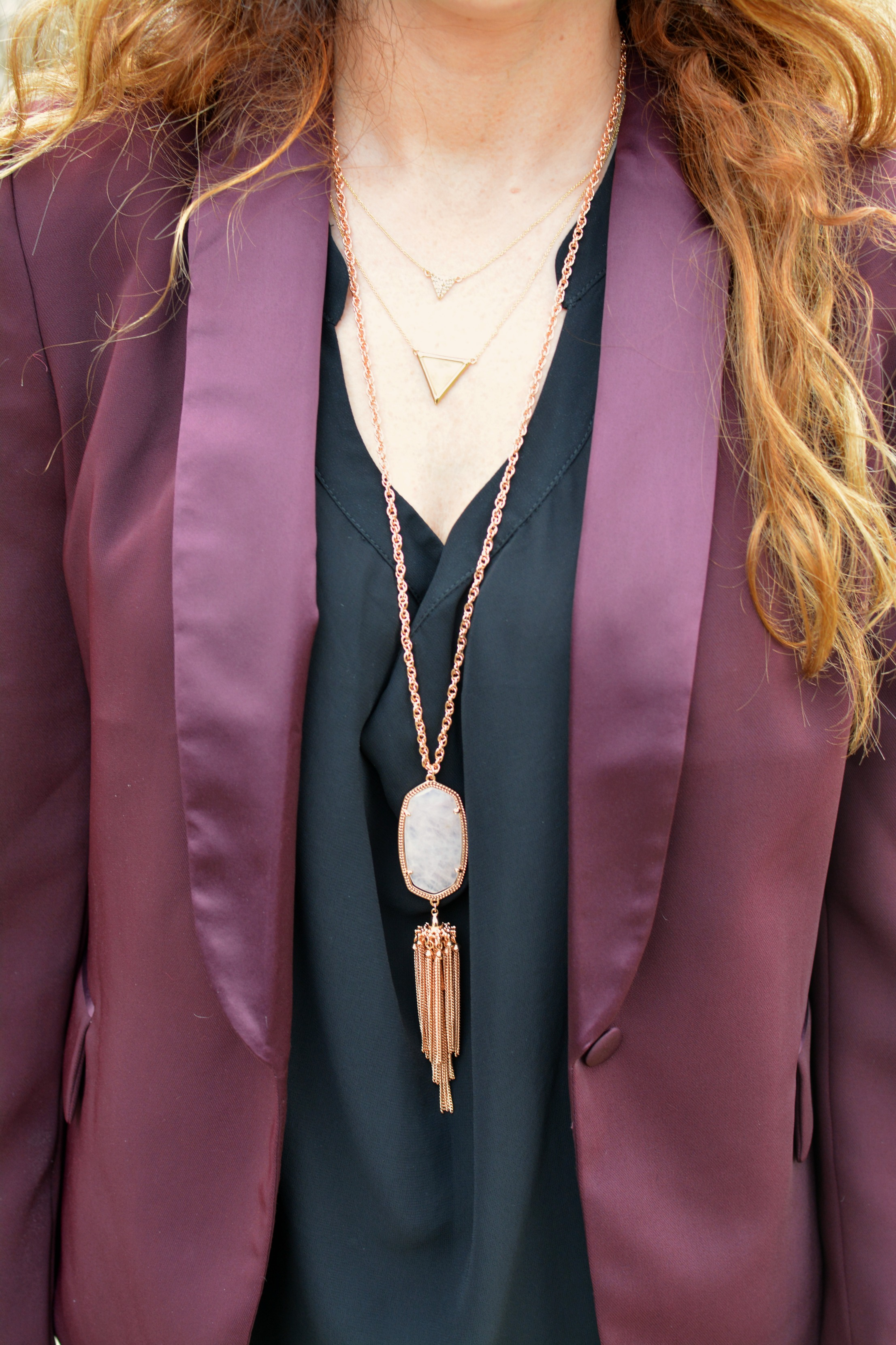 Ashley from LSR in a burgundy blazer and necklaces from Kendra Scott and House of Harlow