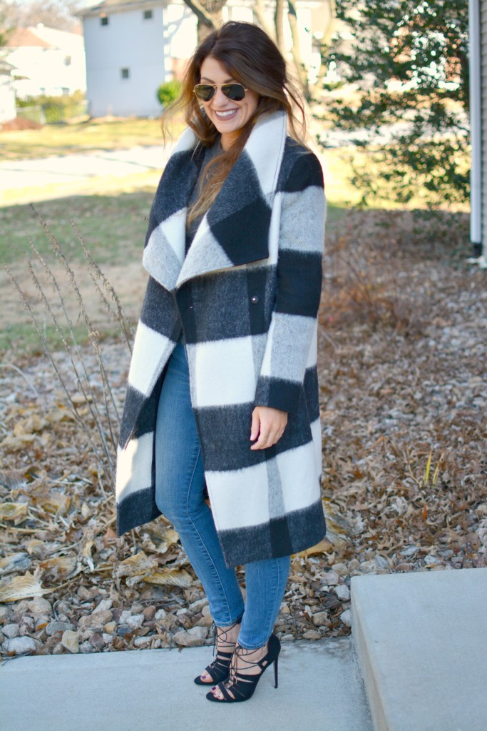 Ashley from LSR in a plaid statement coat, Gap jeans, and black lace-up sandals