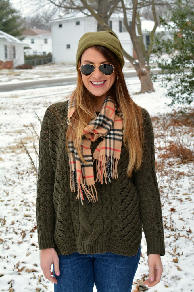 Ashley from LSR in an olive sweater, a beanie, and a Burberry scarf