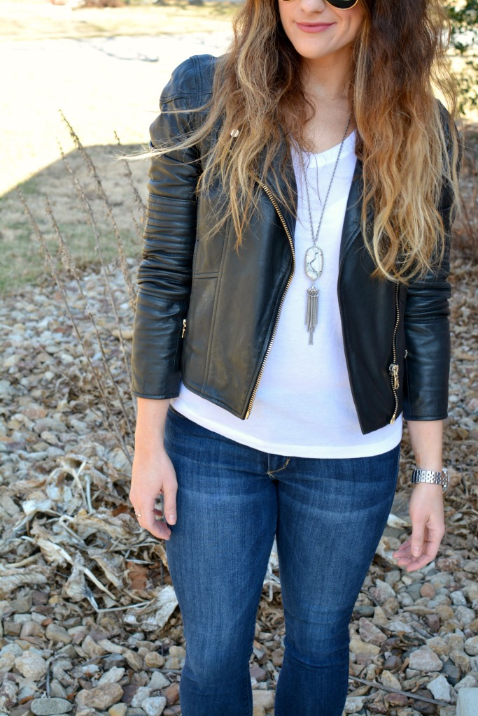 Ashley from LSR in a leather biker jacket and a Kendra Scott Rayne necklace