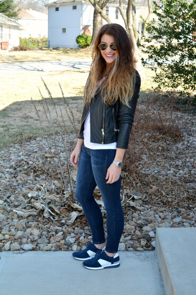 Ashley from LSR in a leather biker jacket and Michael Michael Kors Allie sneakers