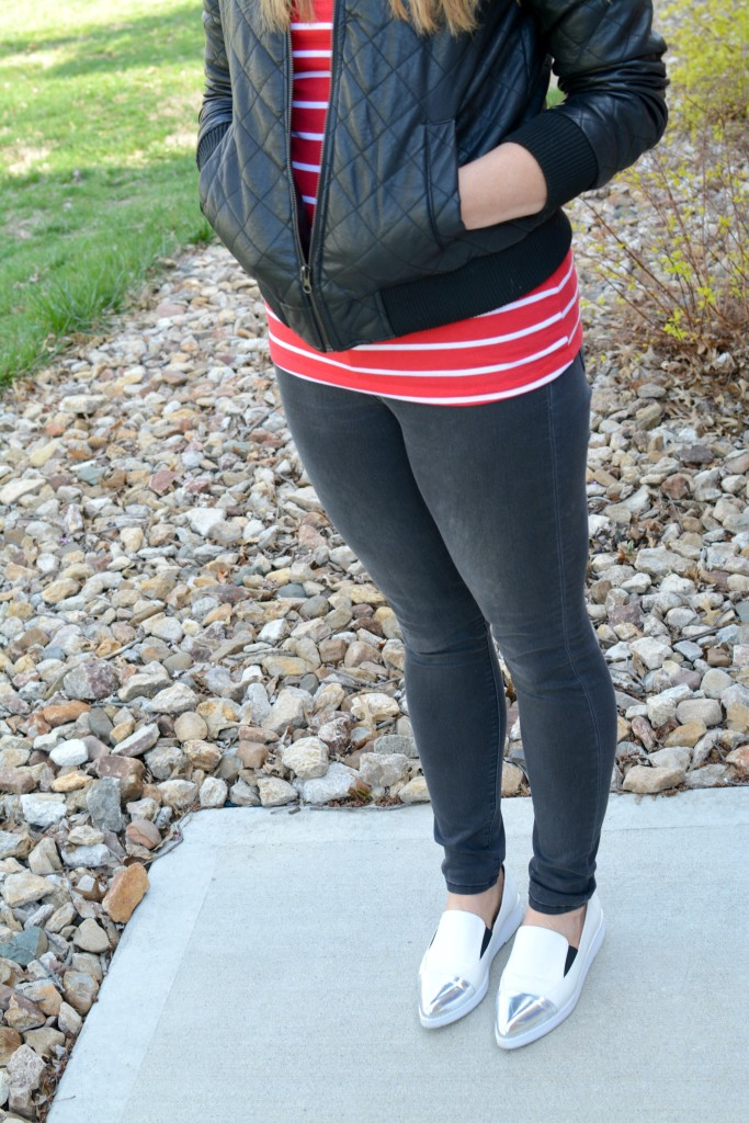 Ashley from LSR in black skinny jeand and white flatforms