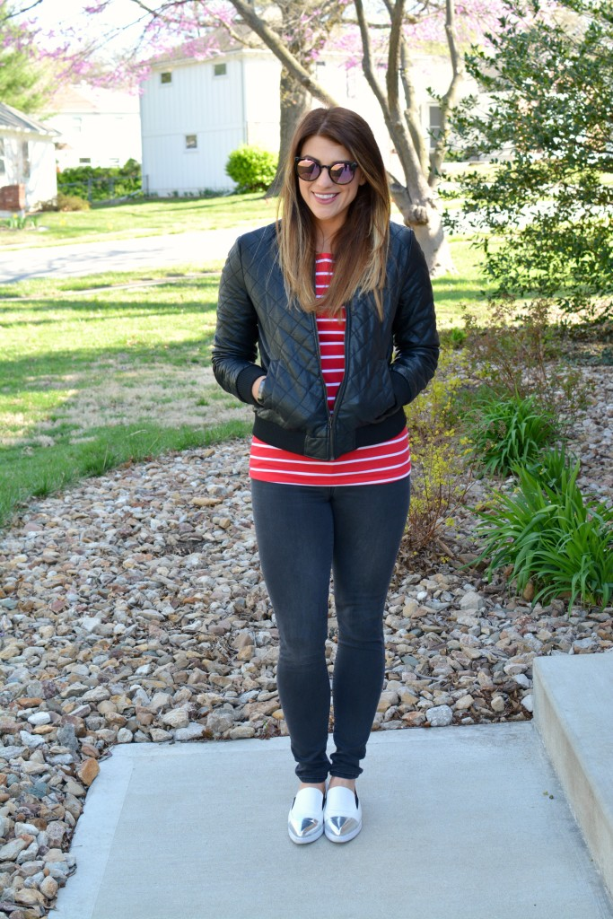 Ashley from LSR in a quilted leather jacket and a red stripe t-shirt