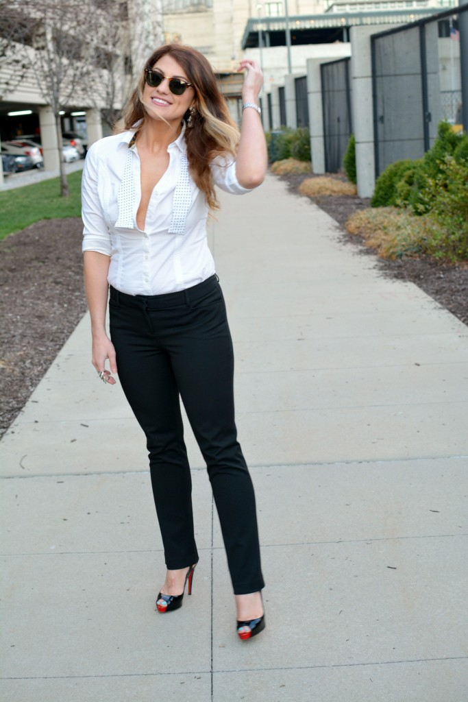 Ashley from LSR in a white shirt and black trousers with a bow tie and Christian Louboutin pumps for KCFW