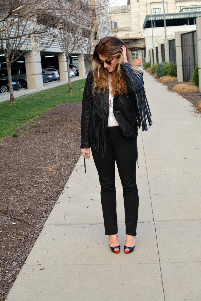 Ashley from LSR in a fringe faux leather jacket and Christian Louboutin pumps for KCFW