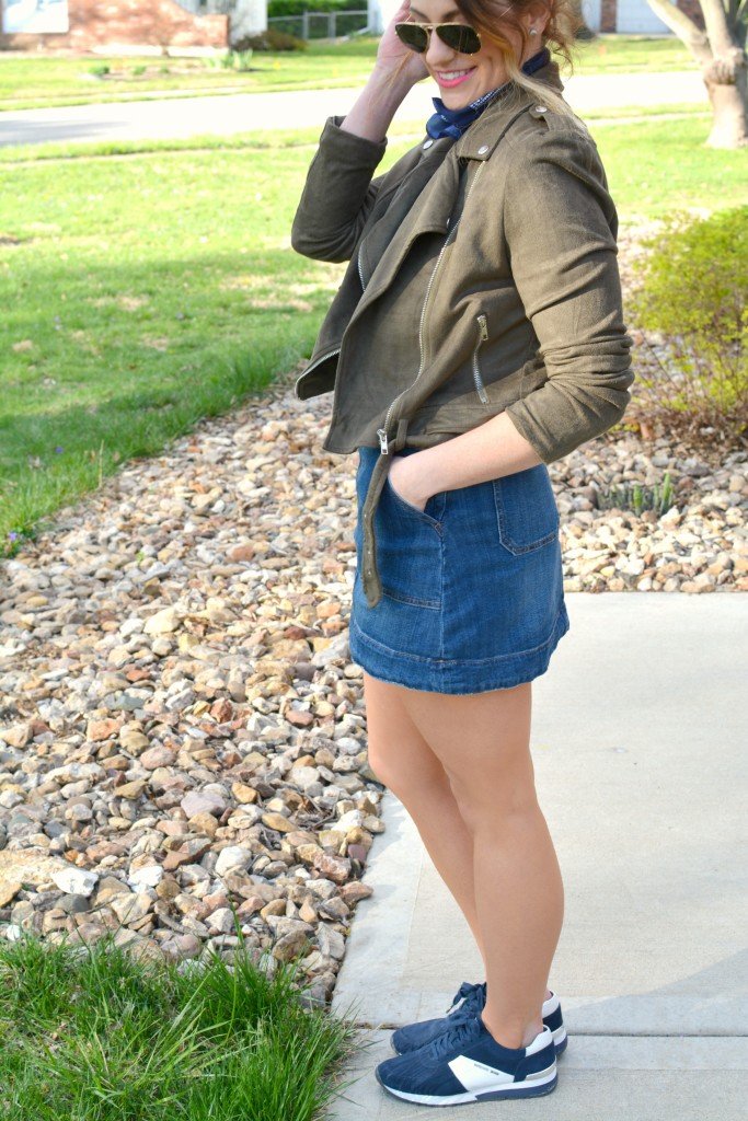 Ashley from LSR in an overall dress, suede jacket, retro sneakers, and a bandanna