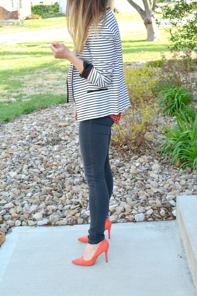 Ashley from LSR in a striped blazer, printed blouse, and bright pumps