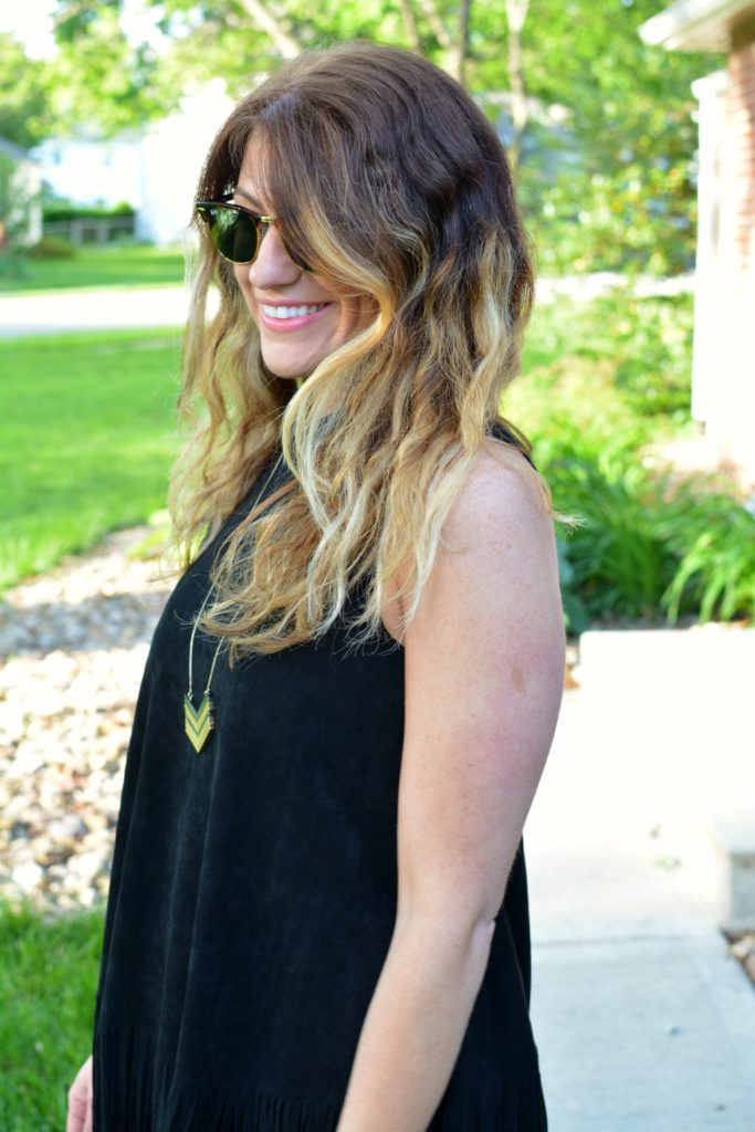 Ashley from LSR wearing a black suede fringe dress and a Madewell arrowstack necklace