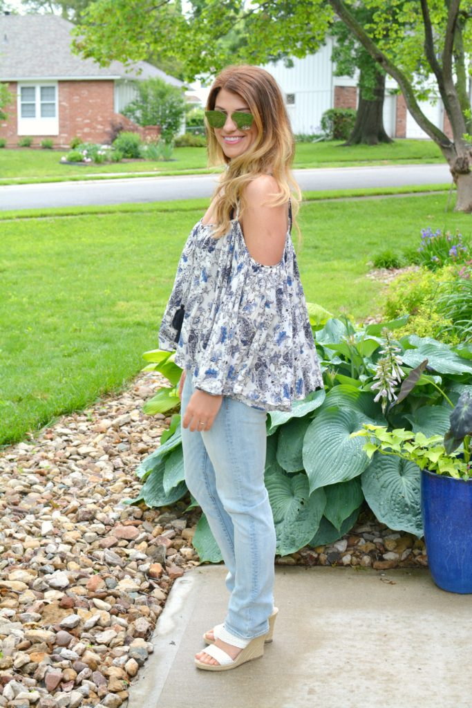 Ashley form LSR in a boho off-the-shoulder top and men's H&M jeans