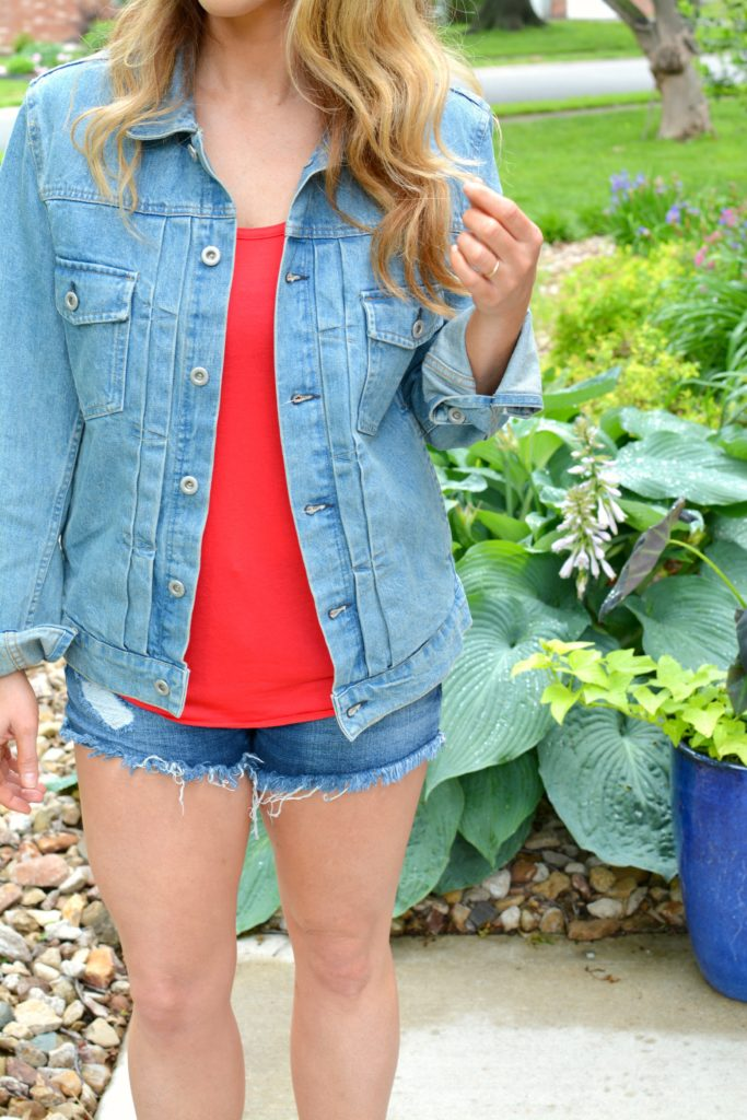 Ashley from LSR in a men's denim jacket and cutoff shorts