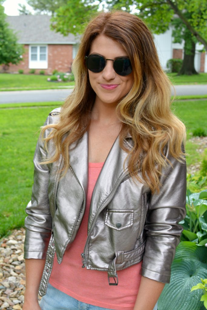 Ashley from LSR in a silver moto jacket and round sunglasses