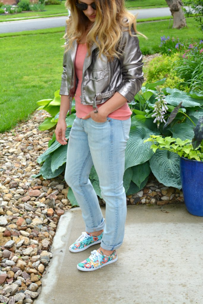 Ashley from LSR in a silver moto jacket, men's H&M denim, and floral sneakers