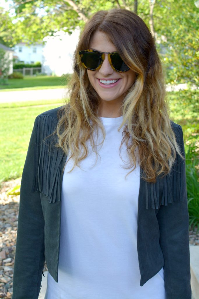 Ashley from LSR in a t-shirt dress and fringe suede jacket